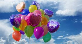 a bunch o colorful balloons